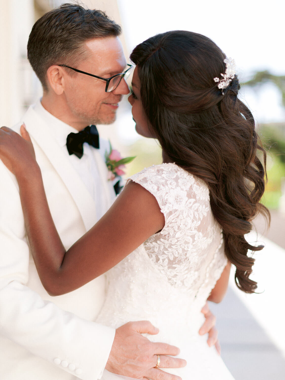 bride and groom affectionate moment in Hotel Palacio Estoril by Portugal Wedding Photographer