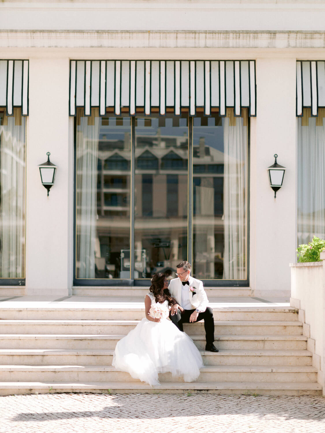 romantic newlyweds after the wedding ceremony at Hotel Palacio Estoril by Portugal Wedding Photographer