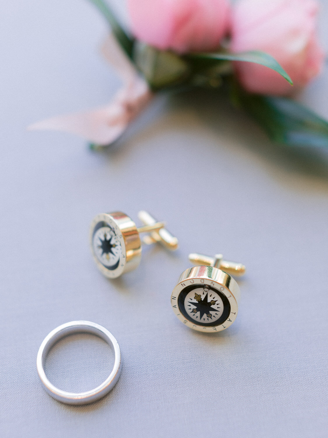 luxurious groom's cufflinks and wedding band by Portugal Wedding Photographer