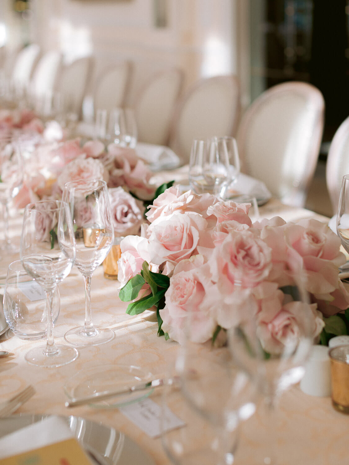 wedding reception table close up with roses centrepieces by Portugal Wedding Photographer