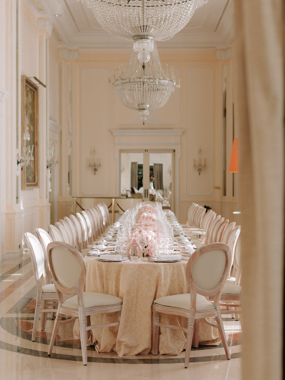 elegant long table for a destination wedding reception in Palacio Hotel Palacio Estoril by Portugal Wedding Photographer