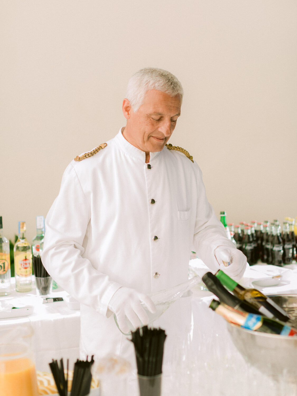 elegant bartender serving drinks during wedding cocktail by Portugal Wedding Photographer