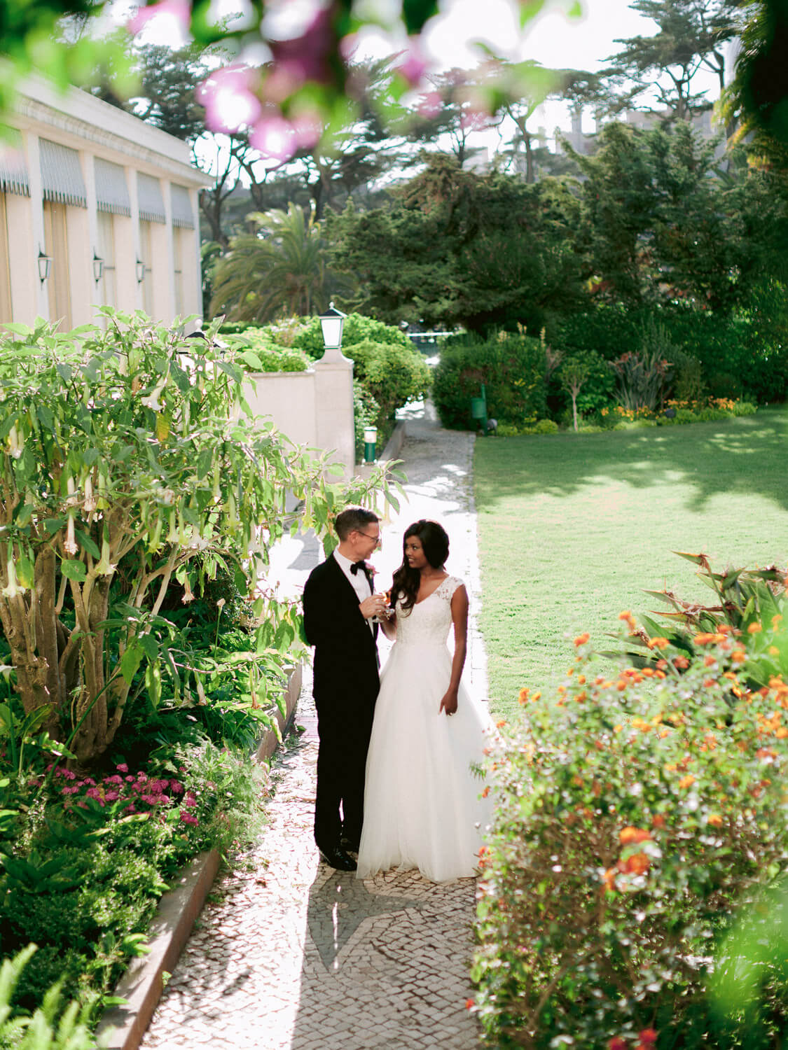 newlywed couple toasting privately in a beautiful garden by Portugal Wedding Photographer