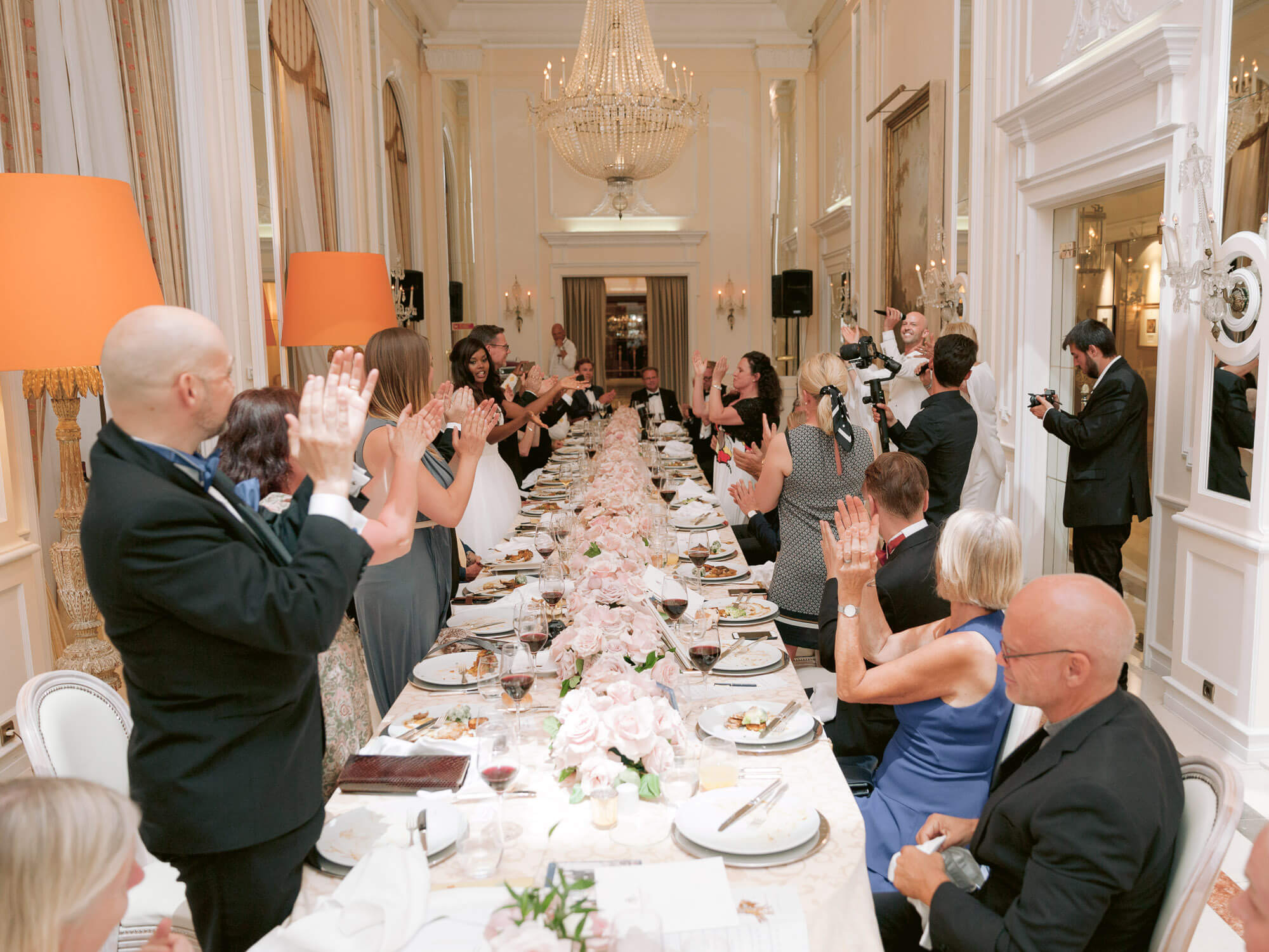 wedding guests clapping and cheering during wedding reception by Portugal Wedding Photographer