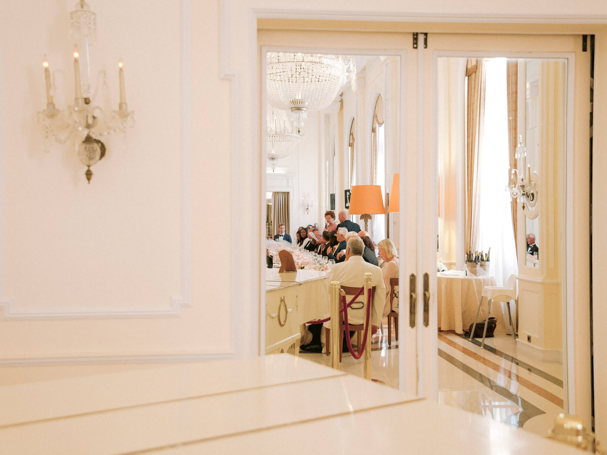 wedding reception table reflection on ornamented mirror doors by Portugal Wedding Photographer