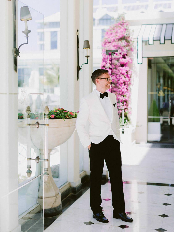 elegant groom in Hotel Palacio Estoril by Portugal Wedding Photographer