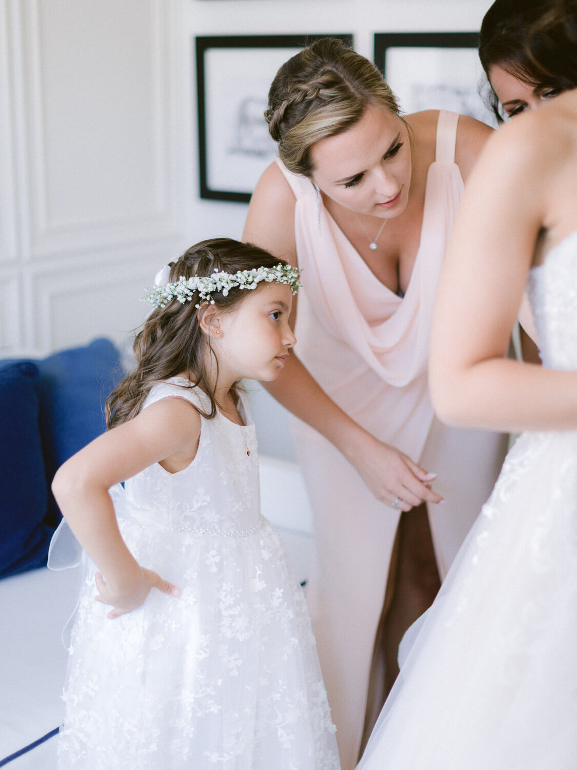 wedding flower girl attentive look at the bride's preparations by Portugal Wedding Photographer