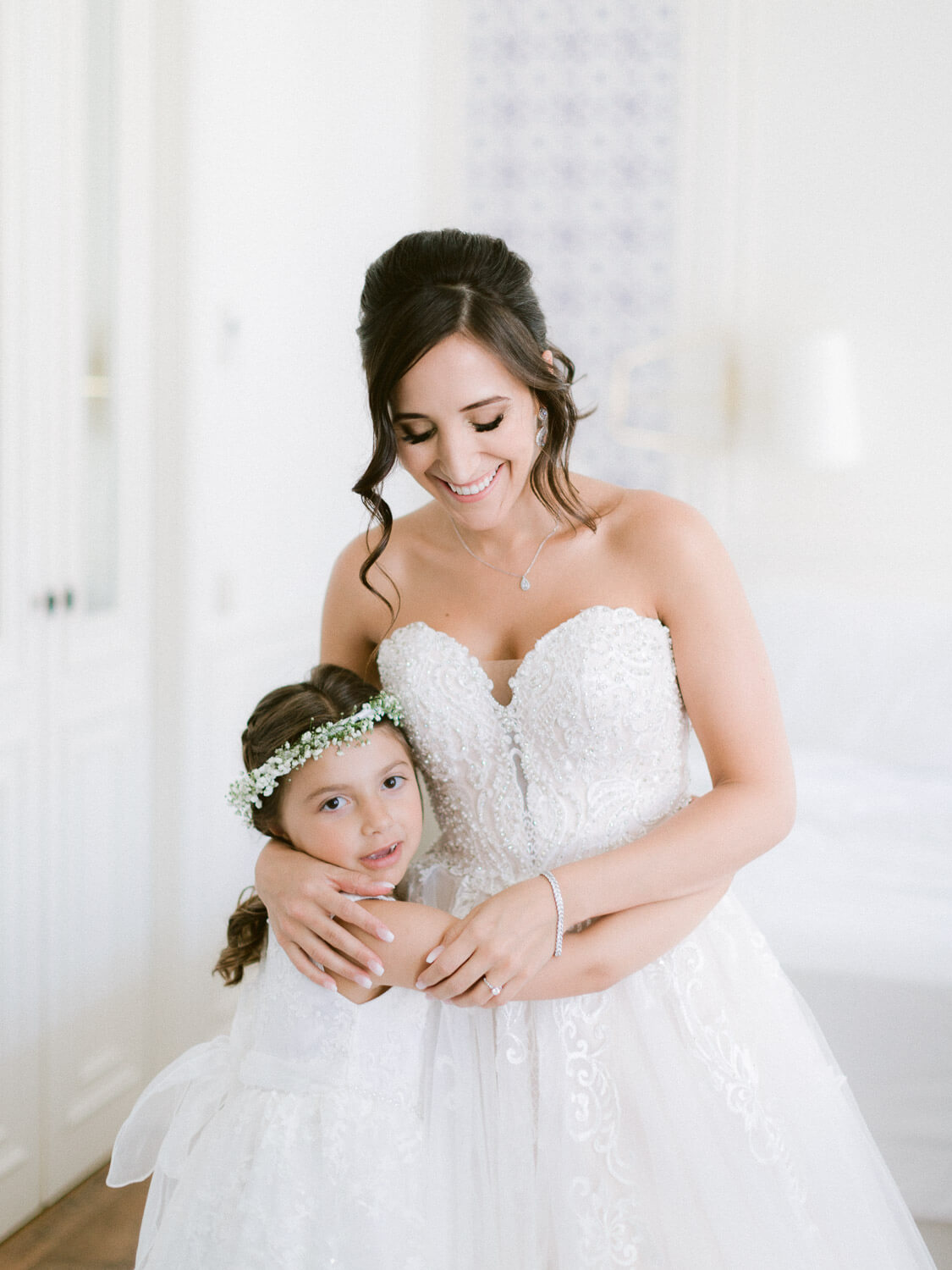 flower girl and bride hugging before wedding in Sintra by Portugal Wedding Photographer