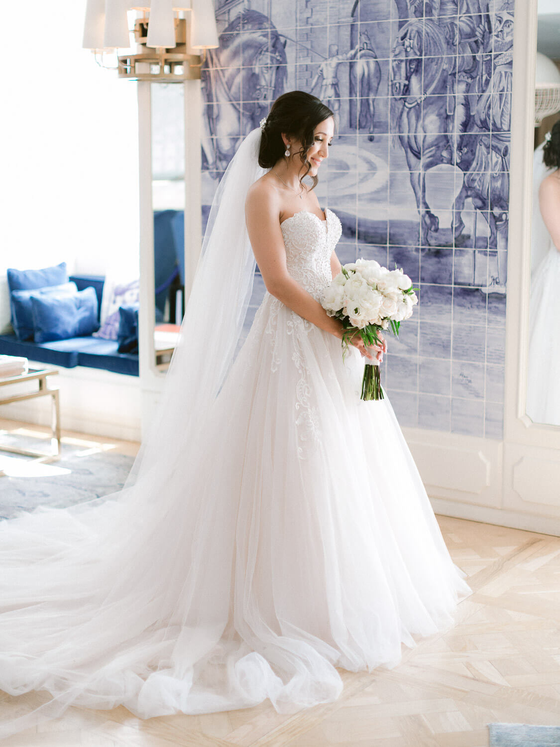 beautiful bride and bouquet portrait with Portuguese Azulejos wall backdrop by Portugal Wedding Photographer