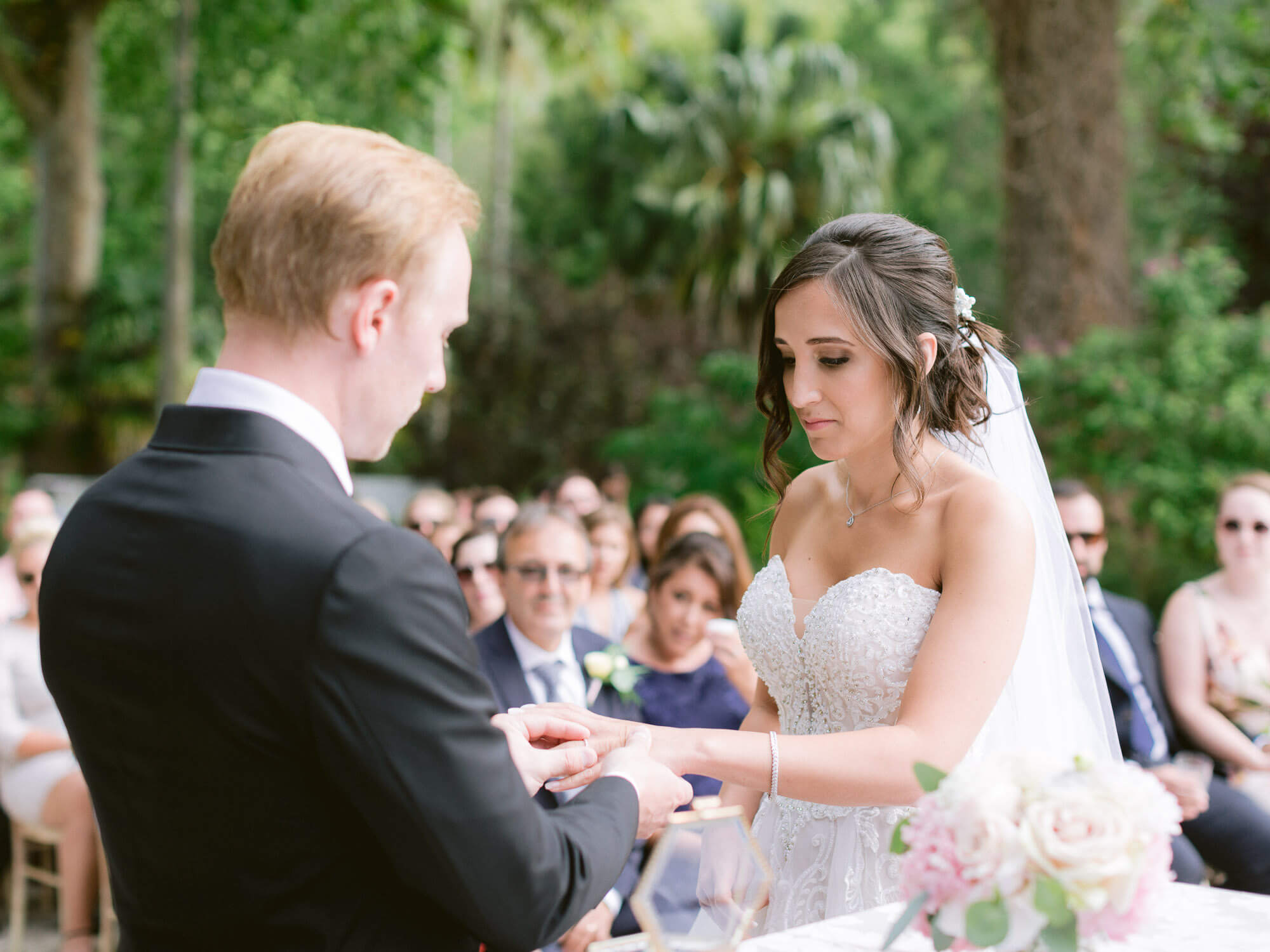 wedding band's exchange moment in Monserrate Palace Sintra by Portugal Wedding Photographer