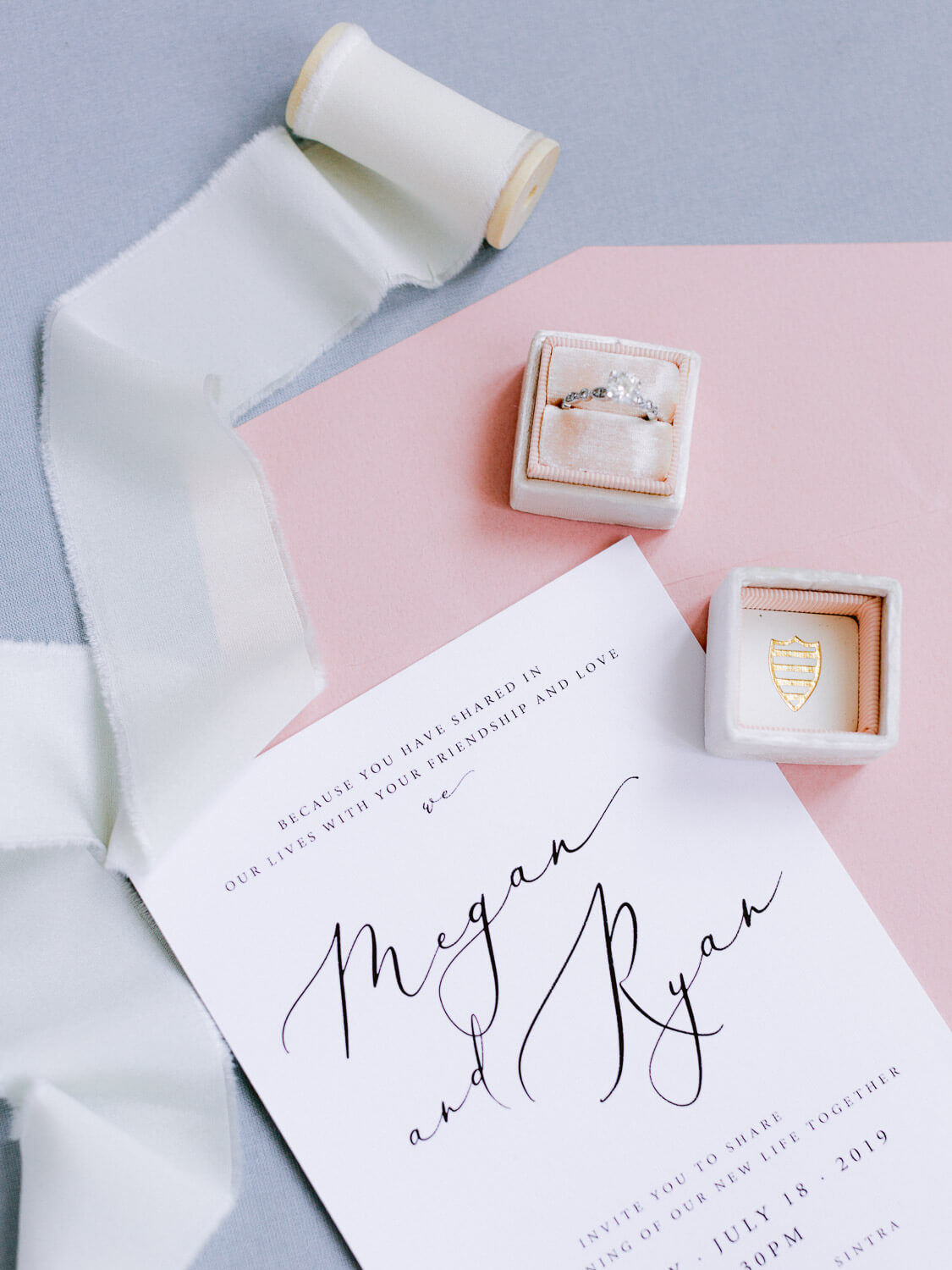 wedding flat lay with diamond ring, invitation and silk ribbon by Portugal Wedding Photographer