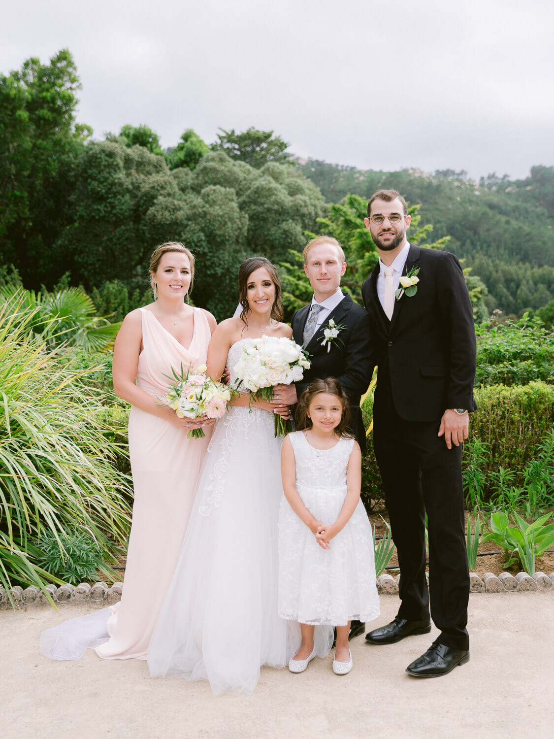 bride, groom, maid-of-honour, best man and flower girl portrait in Monserrate Palace Sintra by Portugal Wedding Photographer