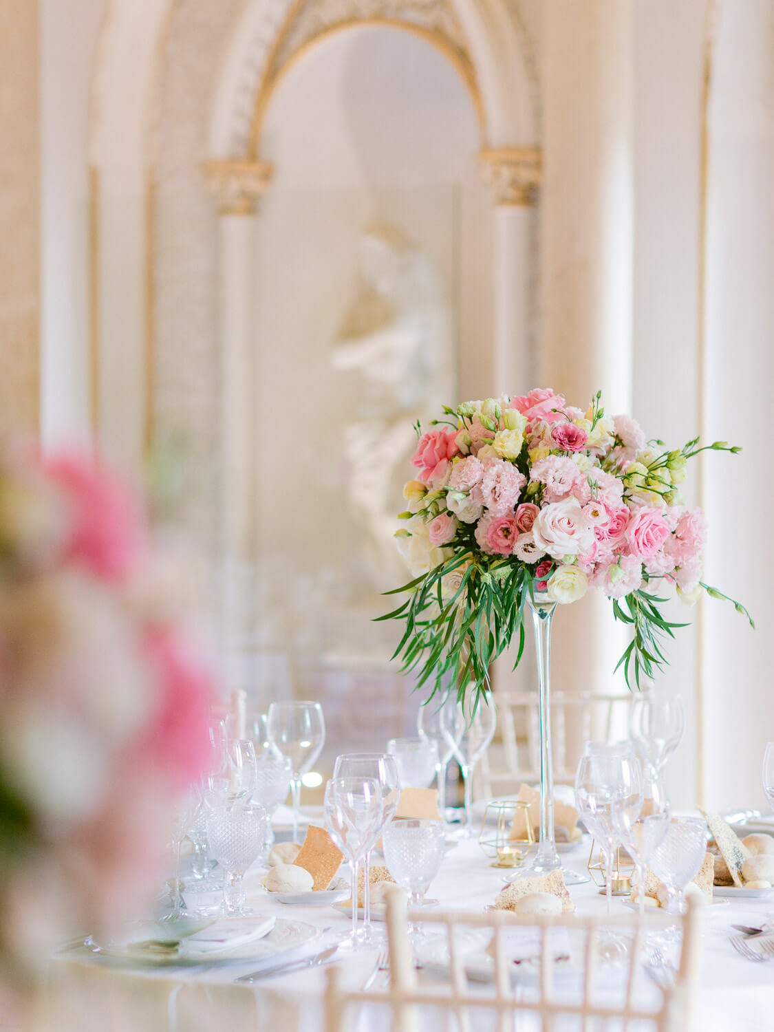 a tall floral centrepiece for a wedding reception in Monserrate Palace Sintra by Portugal Wedding Photographer