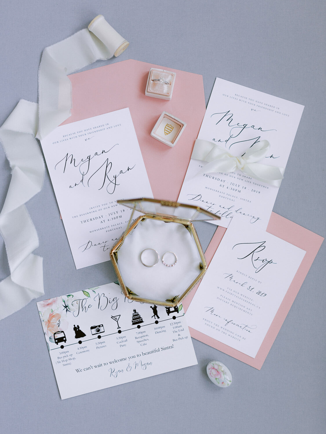 wedding in Sintra flat lay with stationery, wedding bands and silk ribbon by Portugal Wedding Photographer