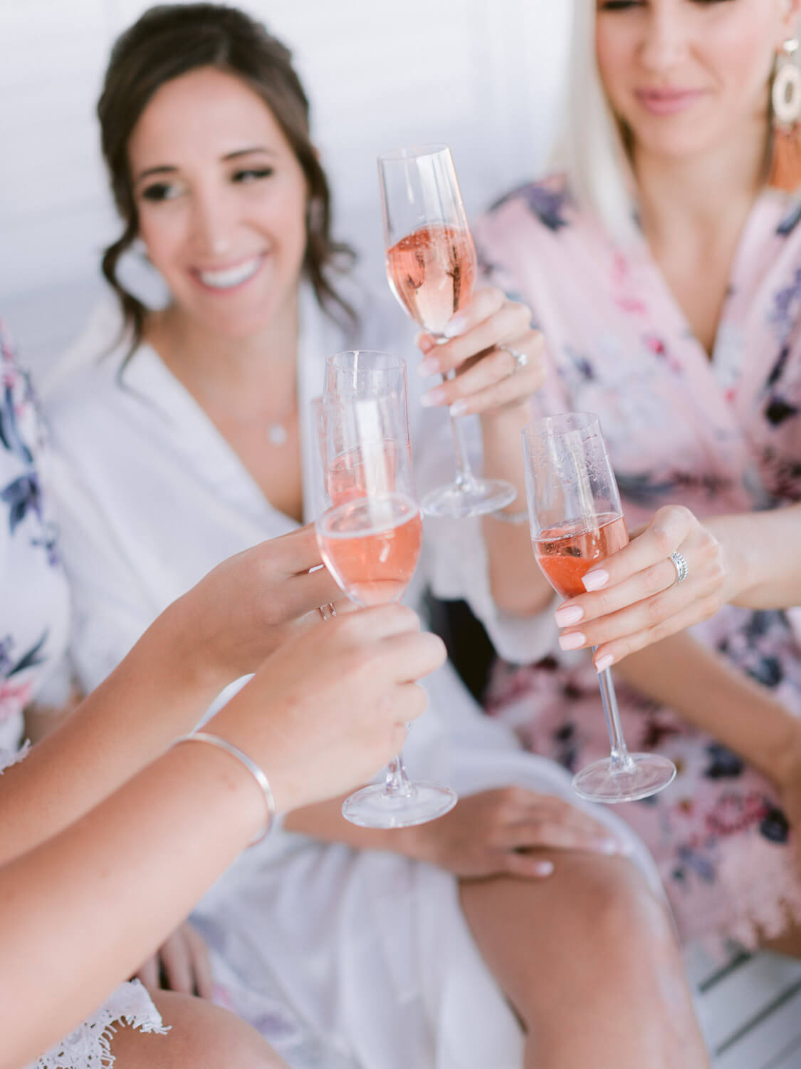 bride and bridesmaid pre-wedding in Sintra toast close up by Portugal Wedding Photographer