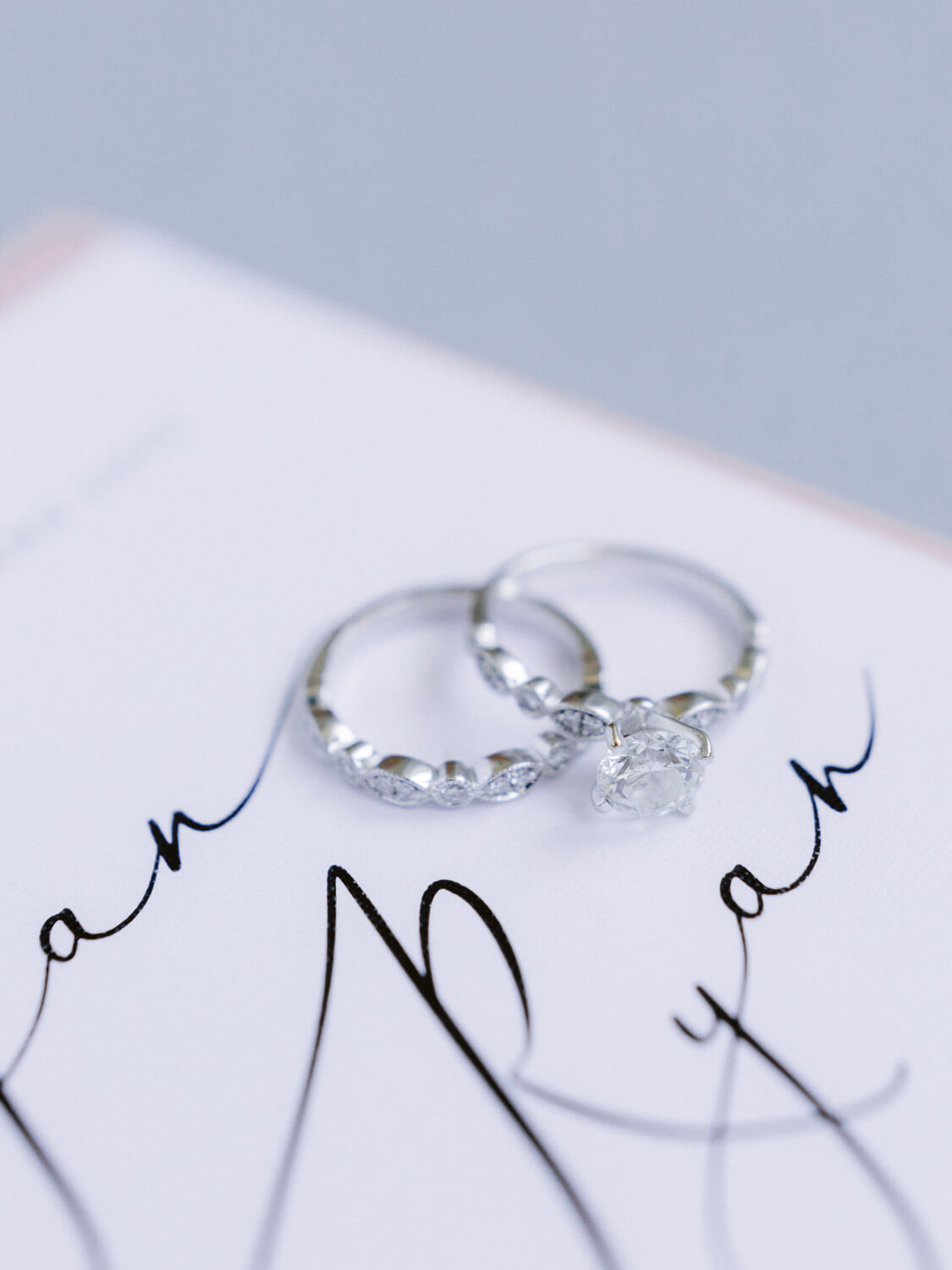 diamond wedding band and engagement ring close up by Portugal Wedding Photographer