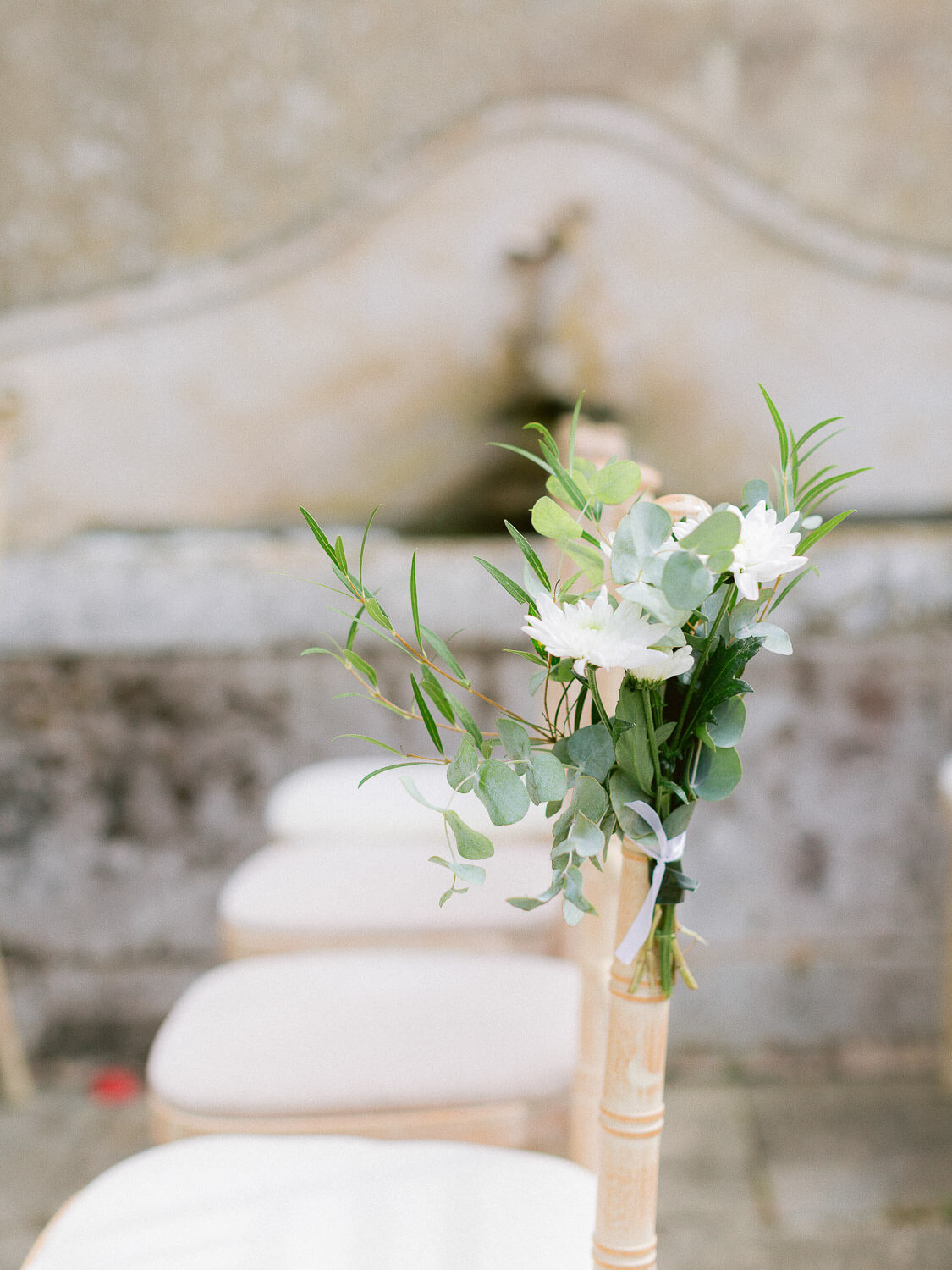 outdoor wedding ceremony decorative floral detail on a chair by Portugal Wedding Photographer