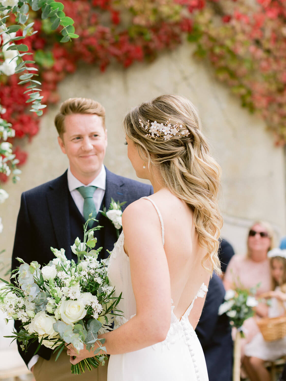 endearing couple look during an outdoor wedding ceremony in Portugal by Portugal Wedding Photographer