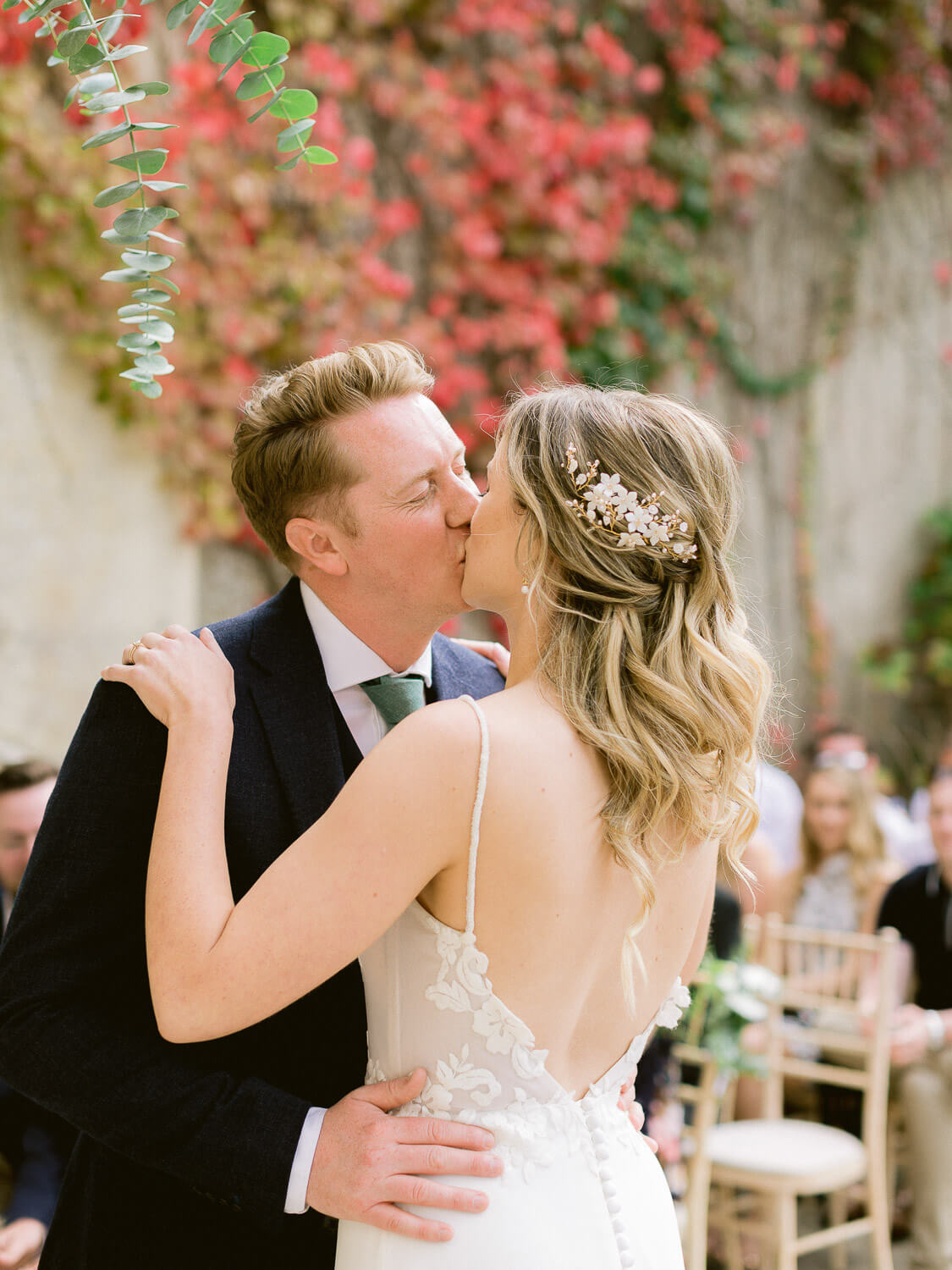 couple's first kiss during a wedding ceremony by Portugal Wedding Photographer