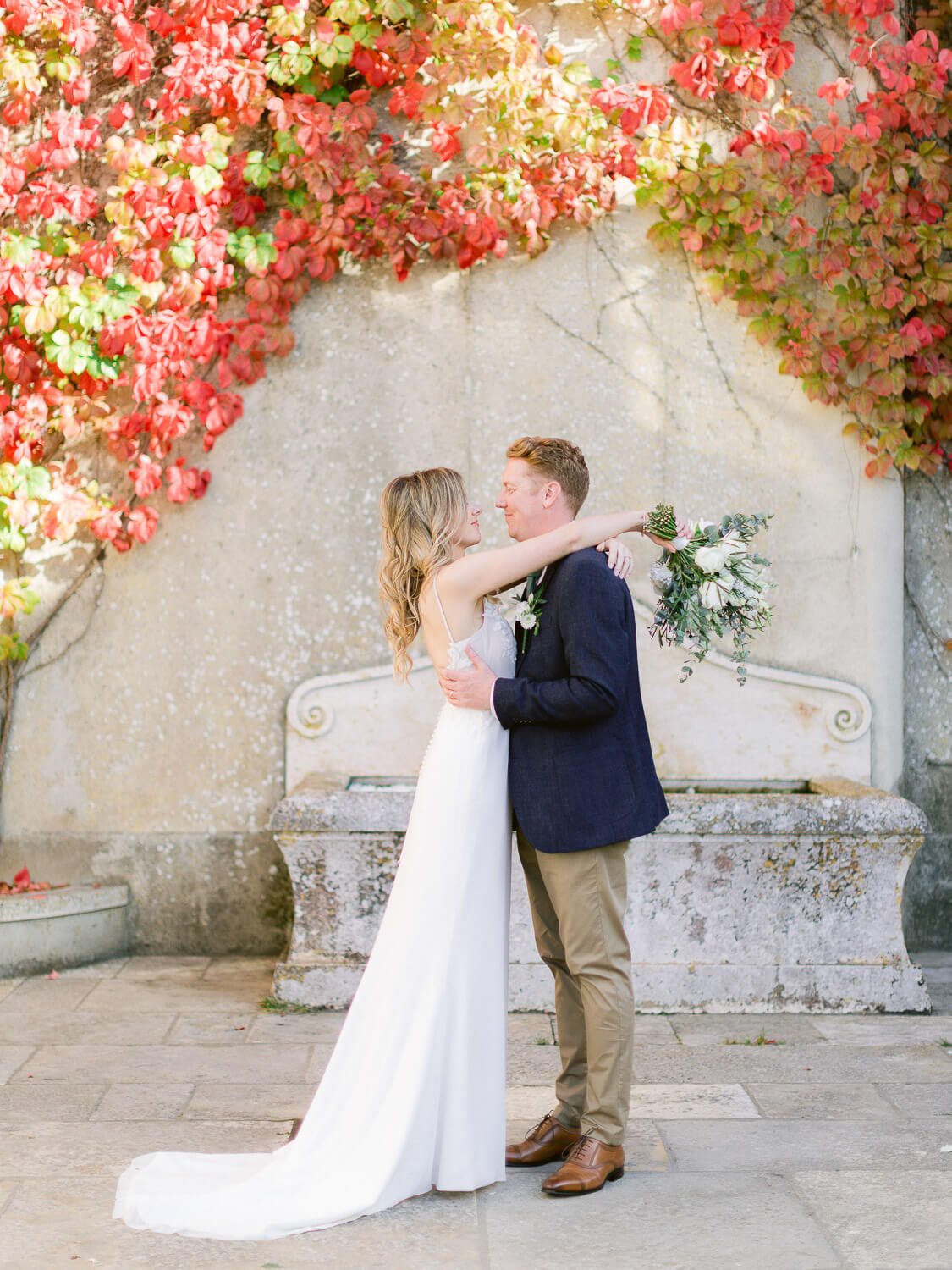newlyweds sweet embrace after wedding by Portugal Wedding Photographer