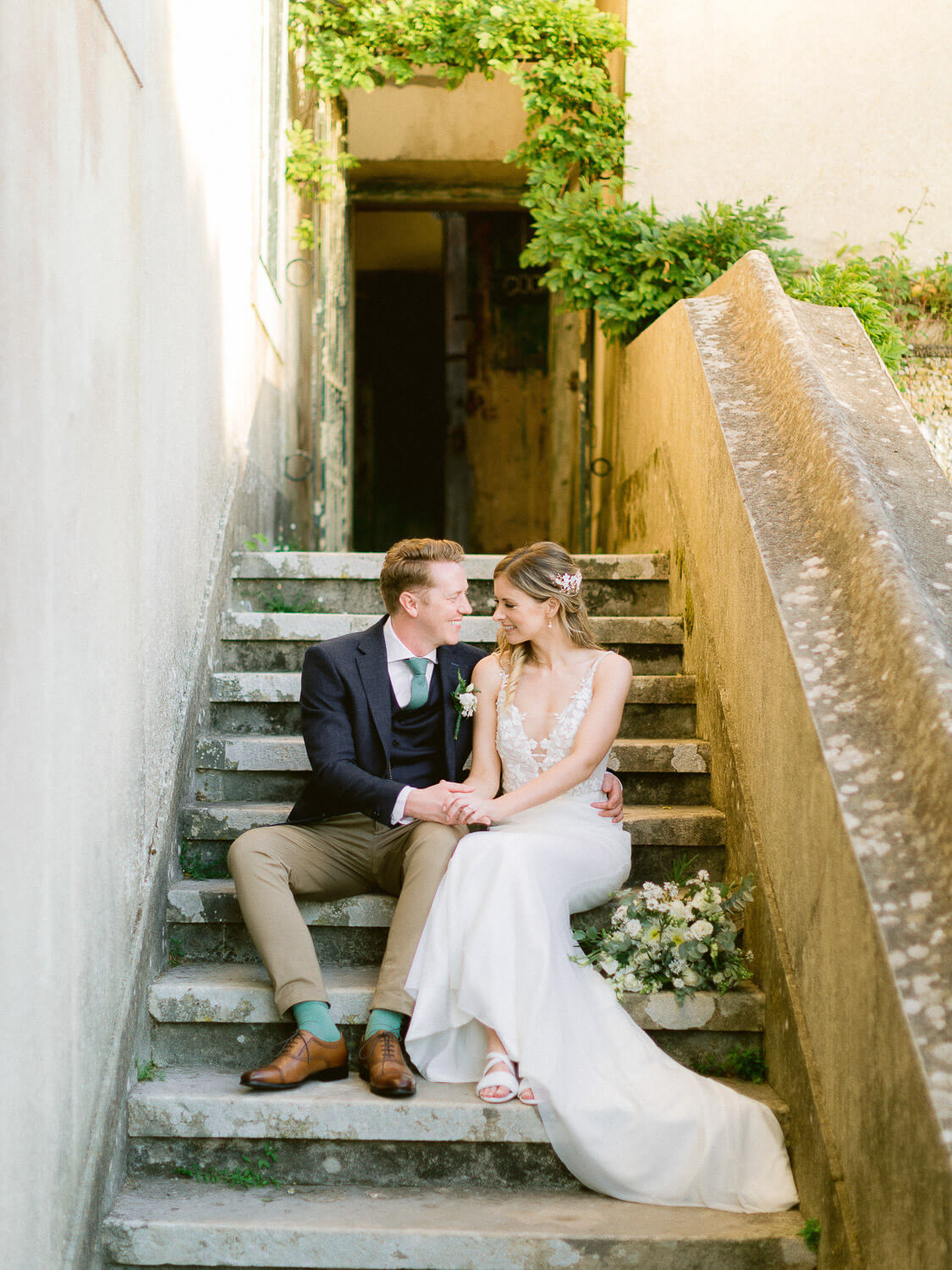 newlyweds sweet portrait on the stoop after the wedding by Portugal Wedding Photographer