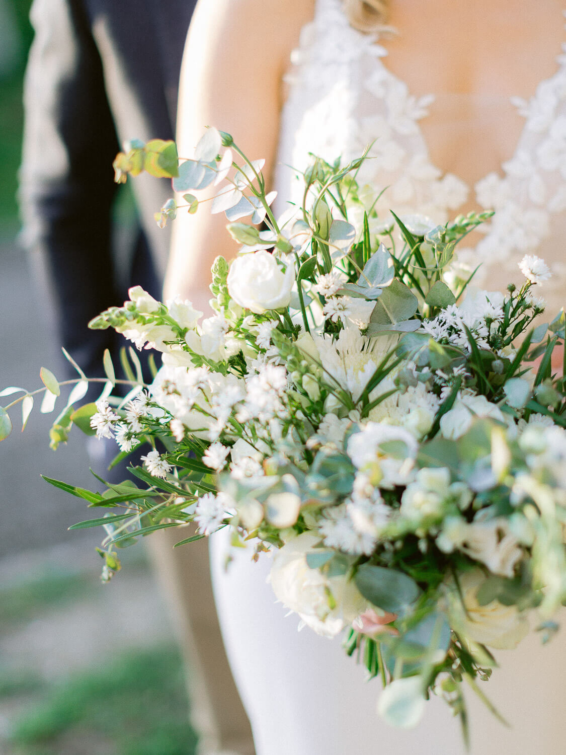 romantic bridal bouquet in white and green hues by Portugal Wedding Photographer