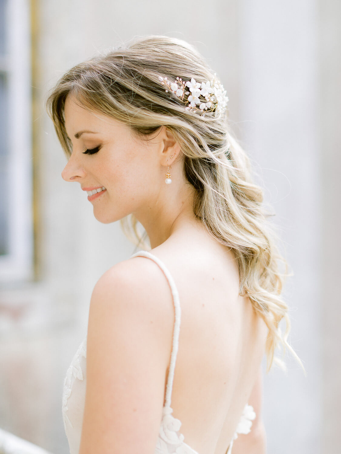 bide's hair-piece and hairdo details in a destination wedding in Portugal by Portugal Wedding Photographer