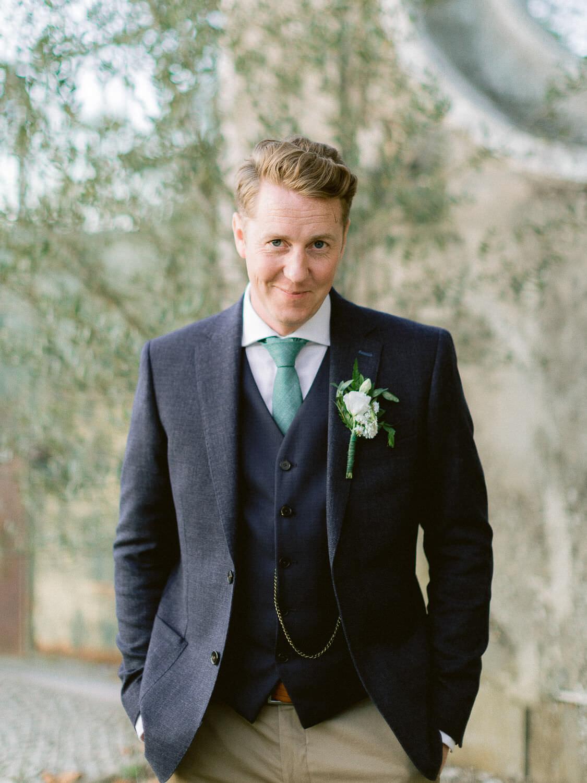 elegant groom portrait after wedding ceremony in Portugal by Portugal Wedding Photographer