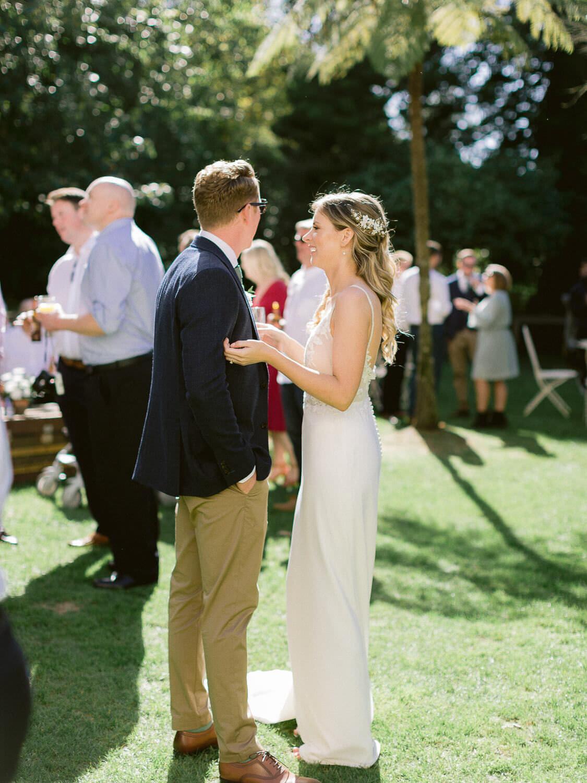 wedding couple enjoying wedding cocktail outdoors by Portugal Wedding Photographer