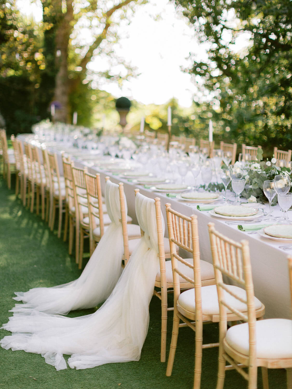 long outdoor reception dinner table in My Vintage Wedding by Portugal Wedding Photographer
