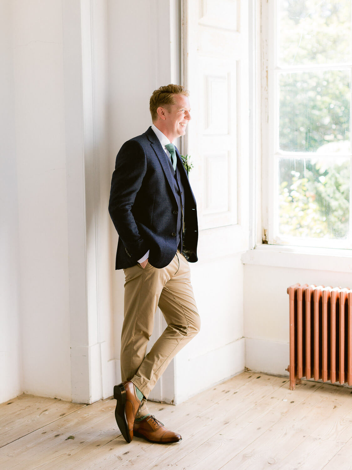 relaxed groom portrait by a window at My Vintage Wedding venue by Portugal Wedding Photographer