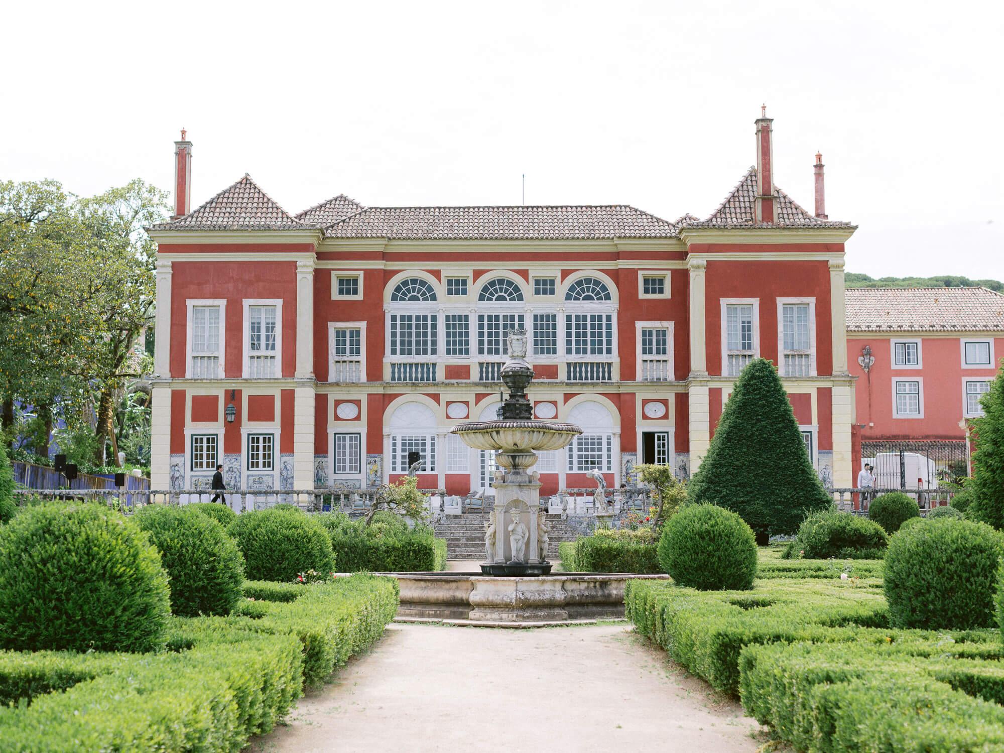 Marques de Fronteira grand crimson coloured facade and french gardens by Portugal Wedding Photographer