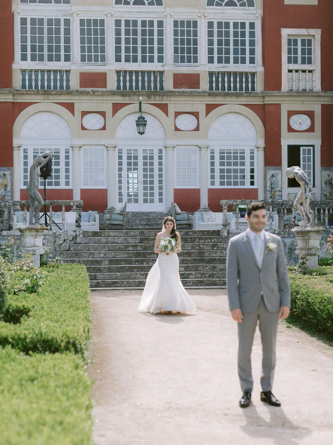 bride and groom's first look in Marques de Fronteira Palace by Portugal Wedding Photographer