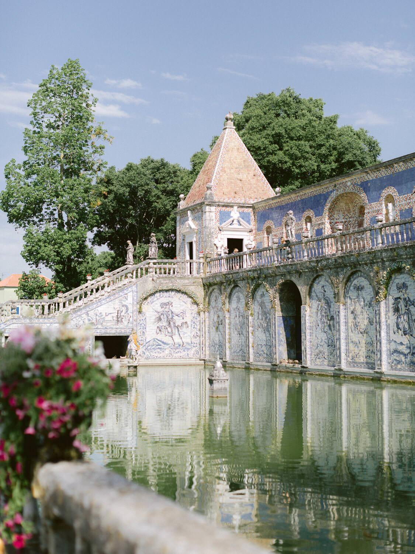 Palacio Marques de Fronteira blue Portuguese tile facade and reflection on lake by Portugal Wedding Photographer