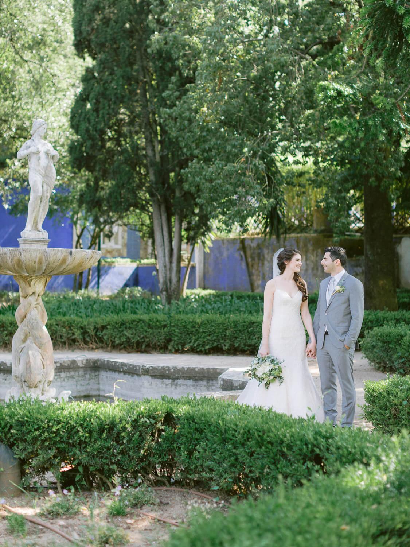 wedding couple romantic look in Palacio de Fronteira french garden by Portugal Wedding Photographer