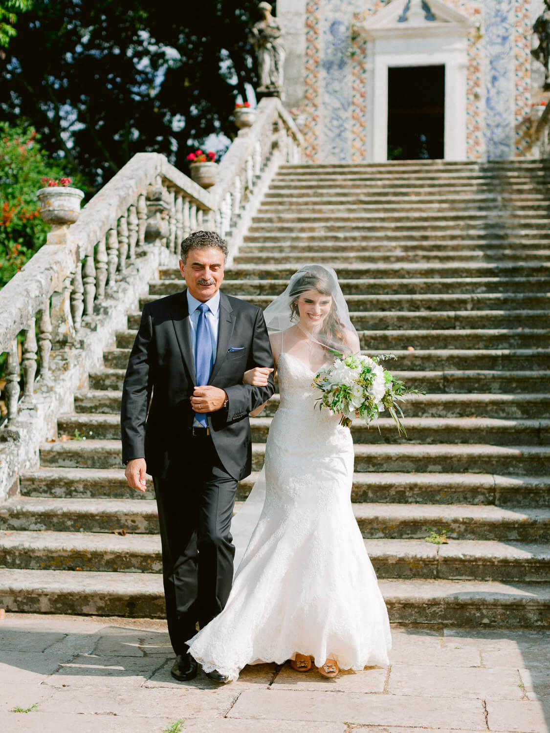 father of the bride walking the bride to the aisle in Marques de Fronteira Palace by Portugal Wedding Photographer