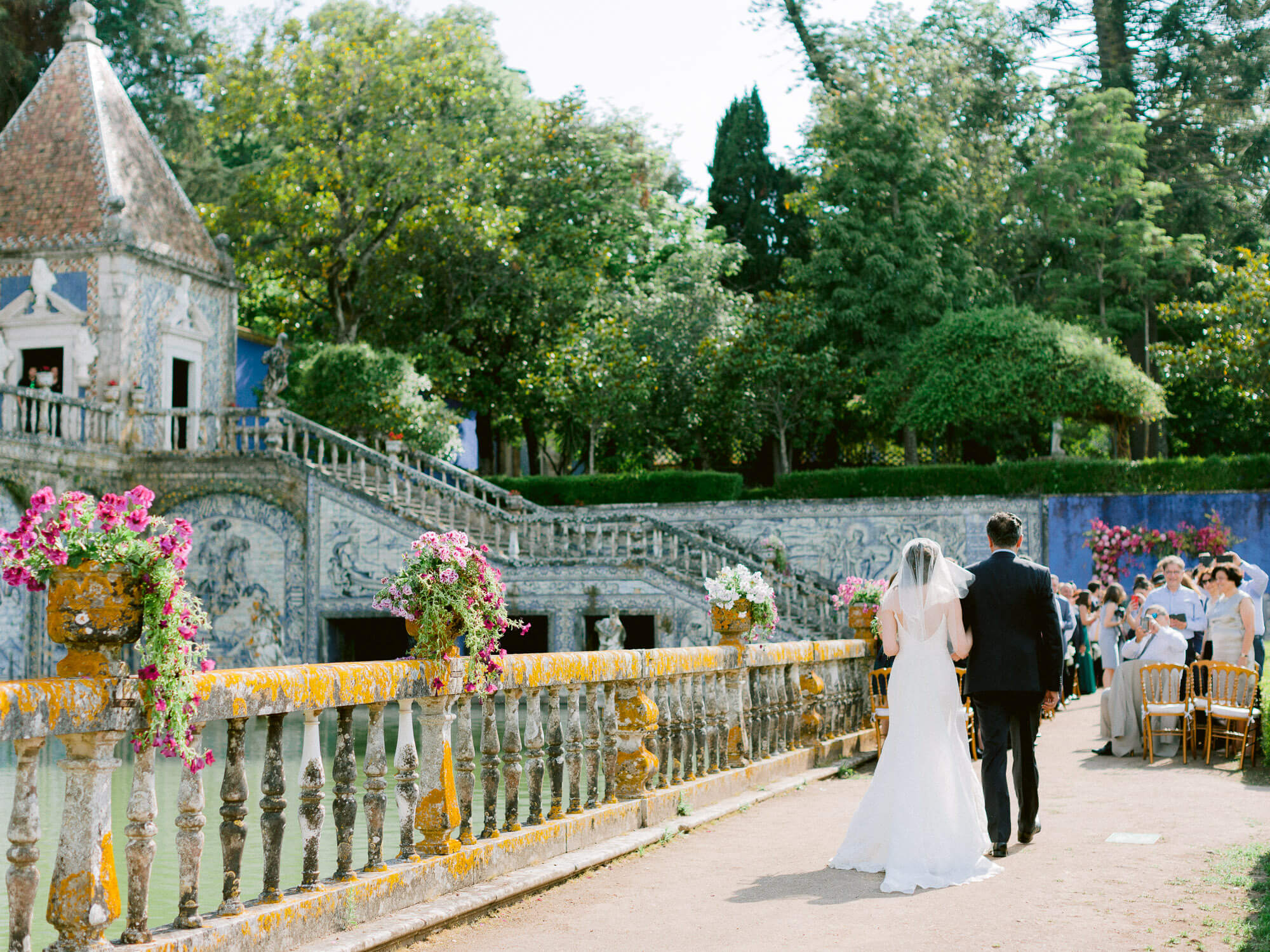 bride and father walking down the aisle in Marques de Fronteira Palace by Portugal Wedding Photographer