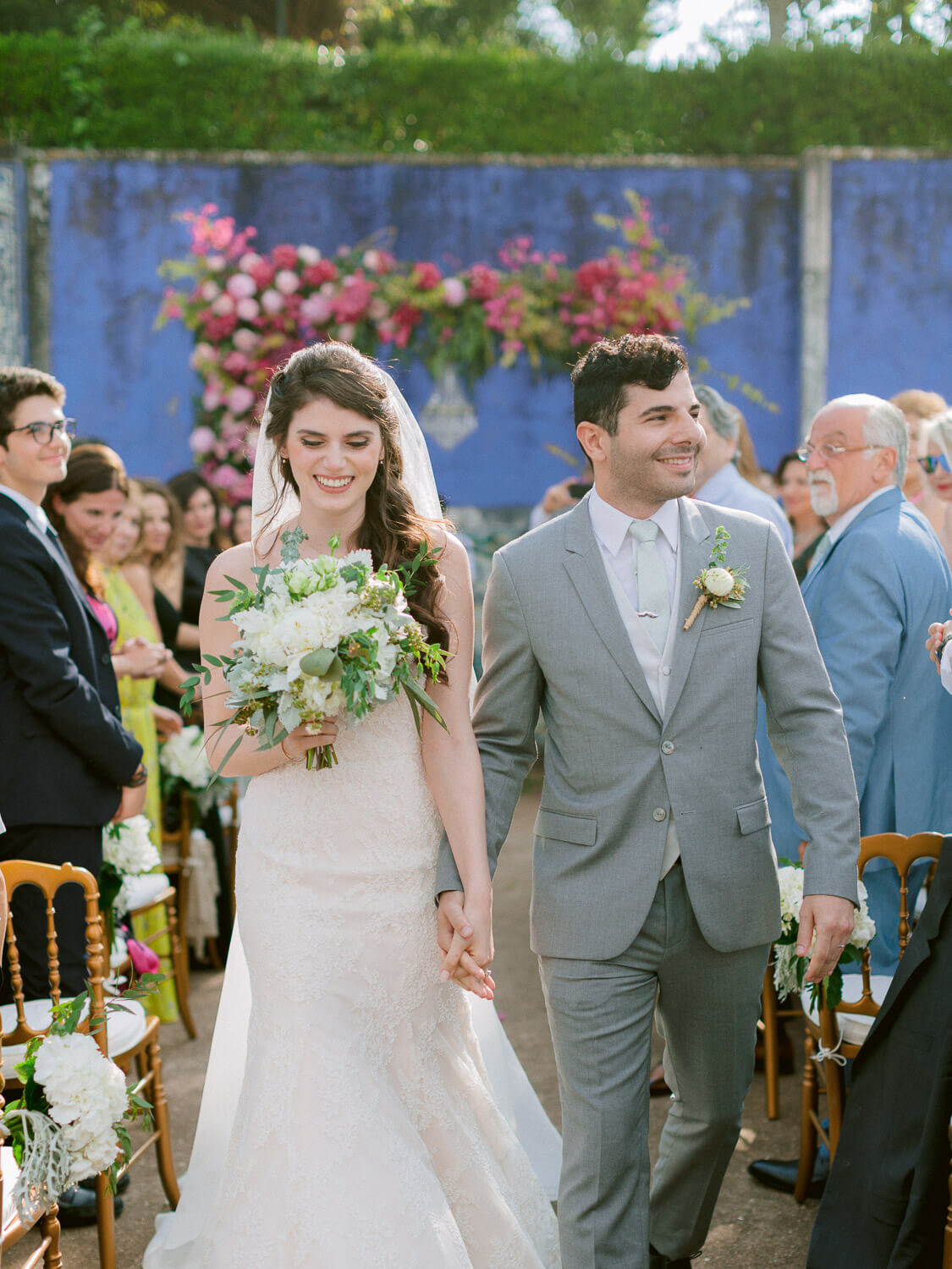 wedding ceremony finale with floral arch background by Portugal Wedding Photographer