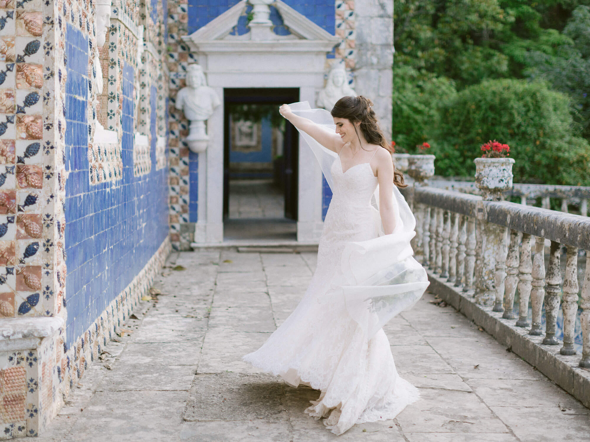 bride dancing in Marques de Fronteira Palace balcony by Portugal Wedding Photographer