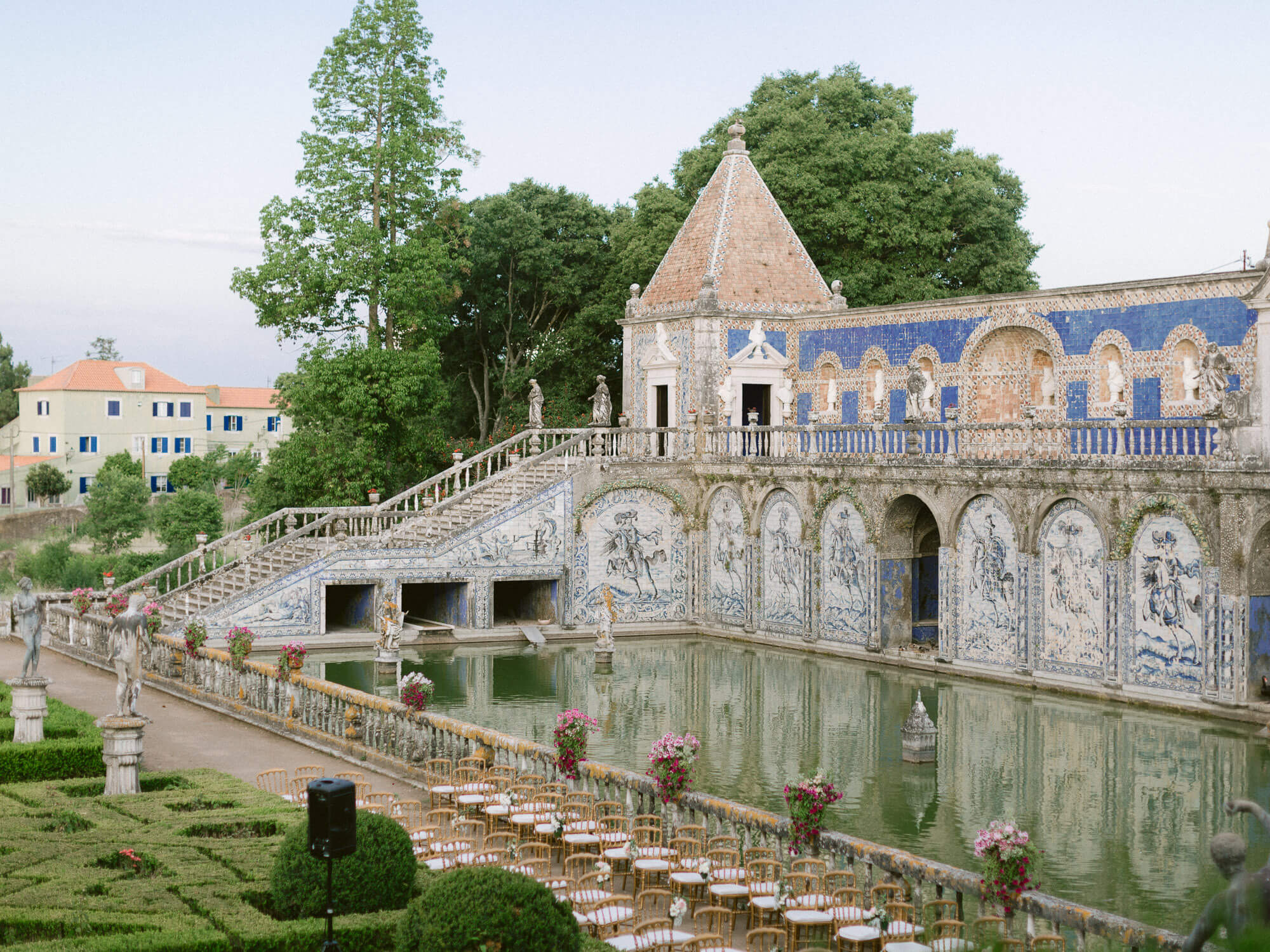 unique Portuguese tile covered facade and lake reflection in Marques de Fronteira Palace by Portugal Wedding Photographer