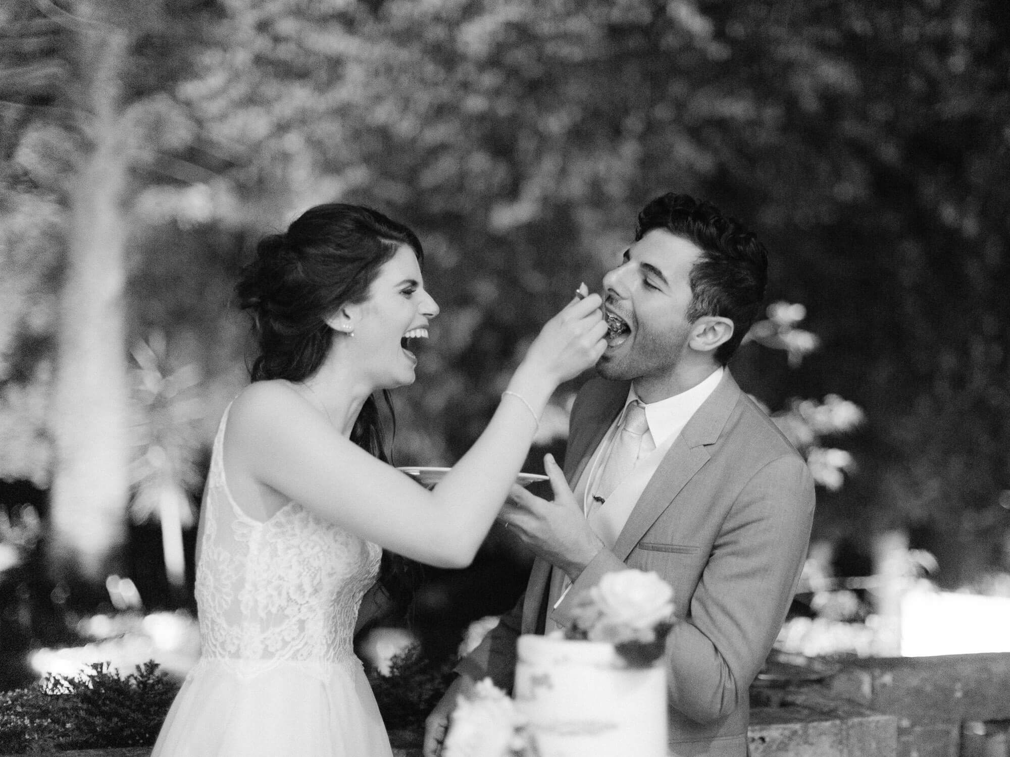 cake cutting ceremony fun moment by Portugal Wedding Photographer