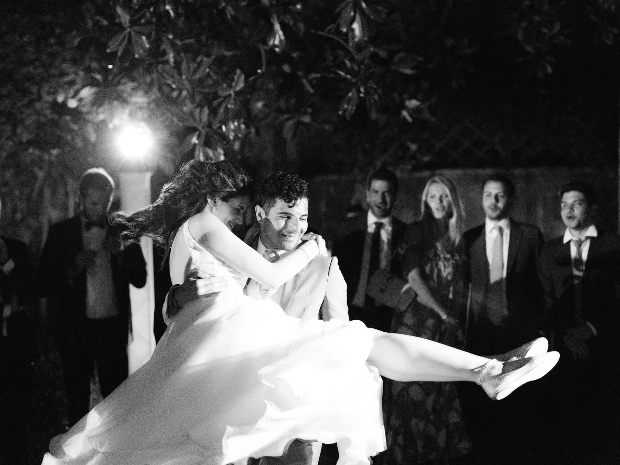 groom lifting bride during wedding first dance by Portugal Wedding Photographer