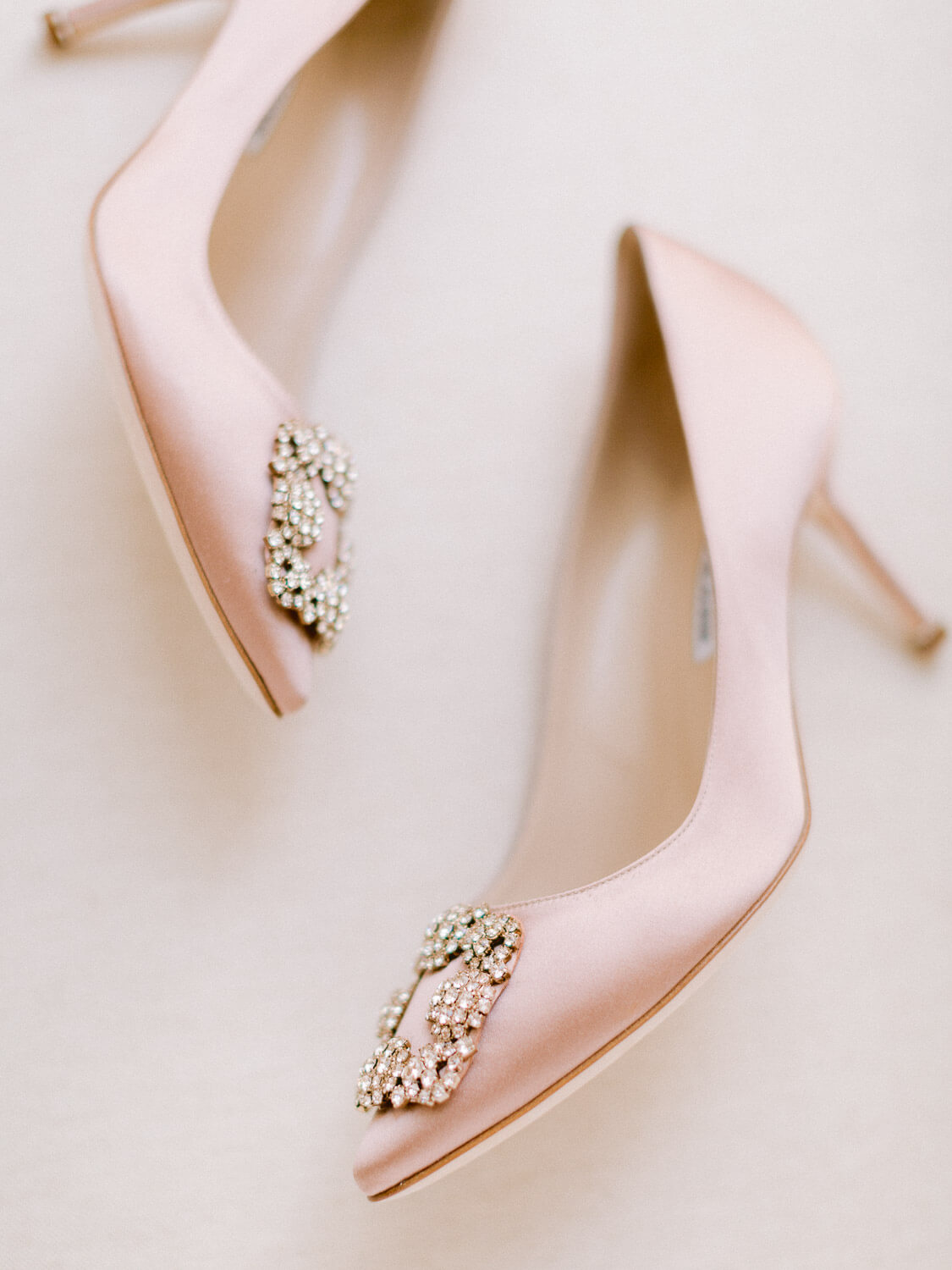 Manolo Blahnik salmon satin pumps with an embellished front detail by Portugal Wedding Photographer