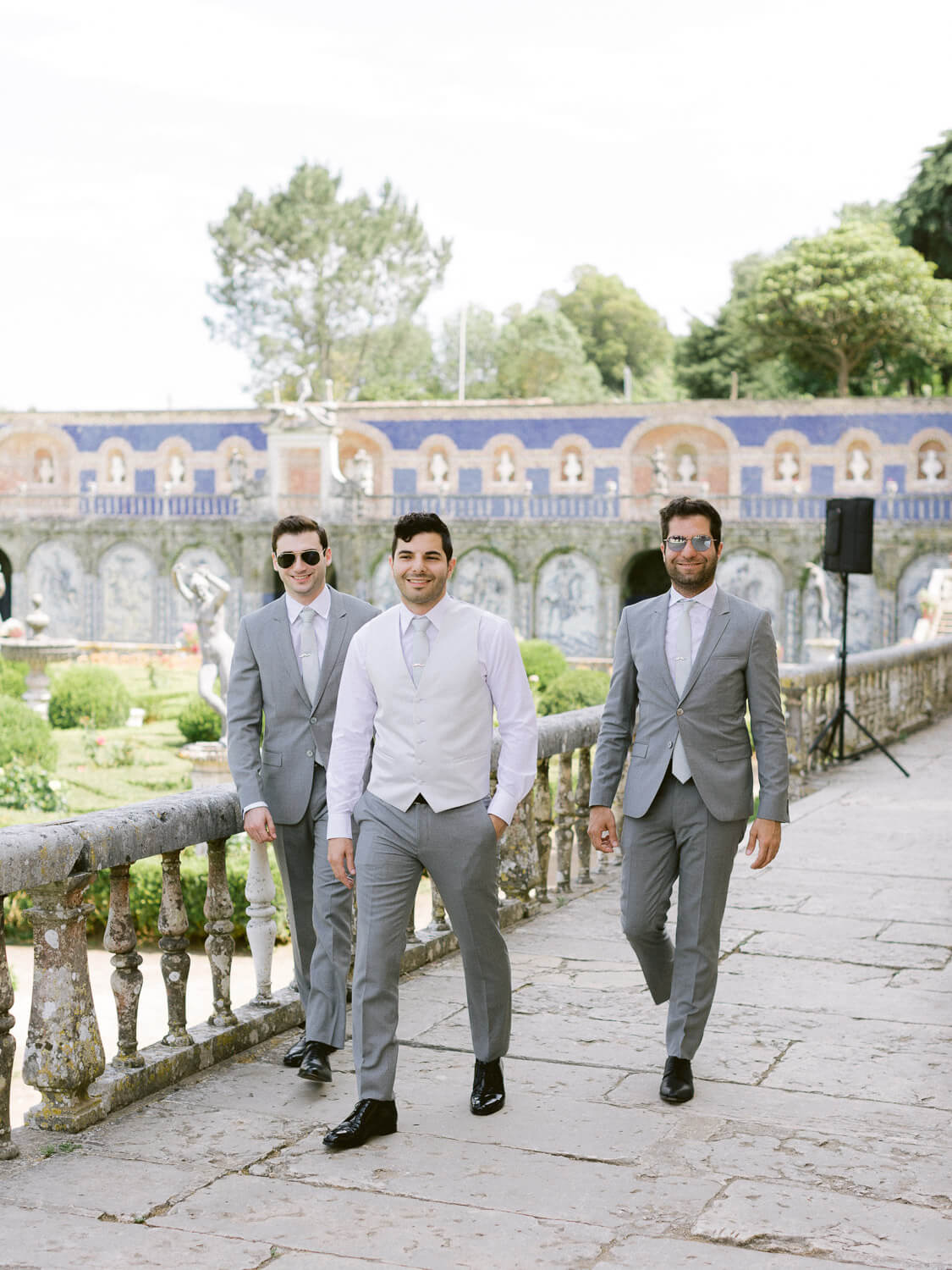 groom and groomsmen in singular Marques de Fronteira Palace wedding venue by Portugal Wedding Photographer