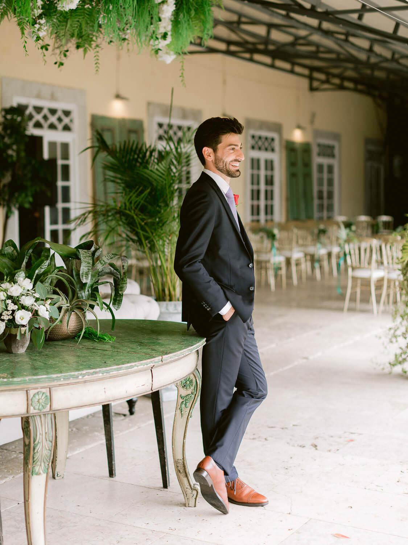 smiling, elegant groom by Portugal Wedding Photographer