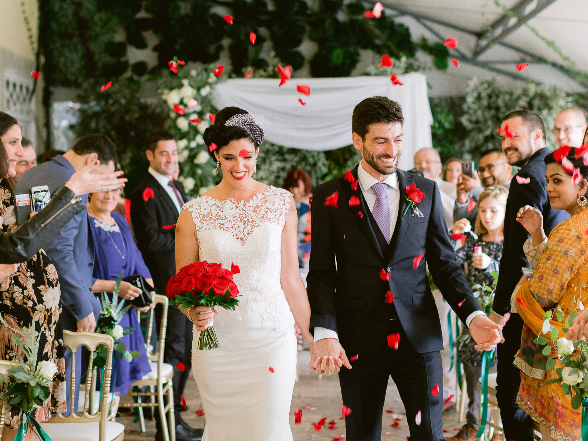 wedding ceremony red petals toss by Portugal Wedding Photographer