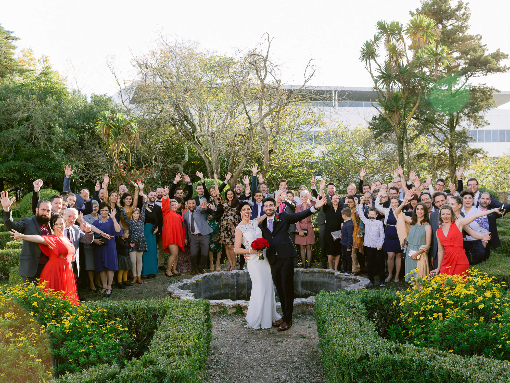 cheering wedding group portrait after wedding ceremony by Portugal Wedding Photographer