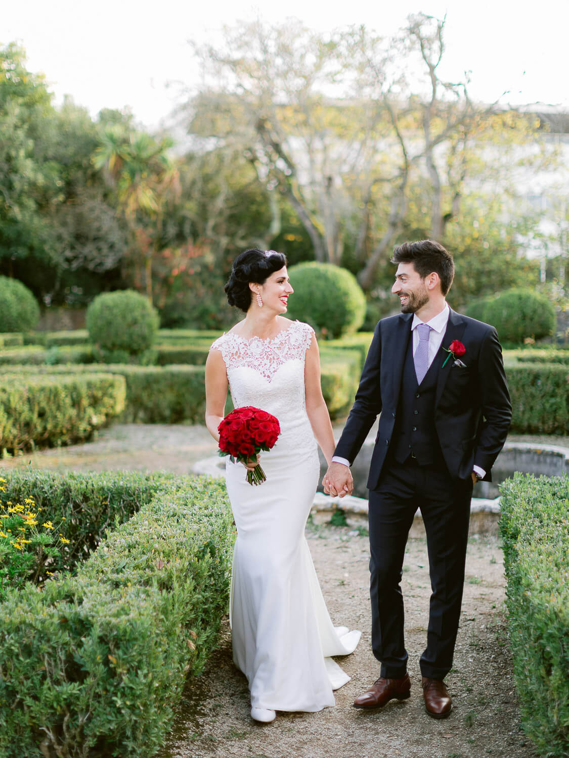 wedding couple romantic stroll on a french garden by Portugal Wedding Photographer
