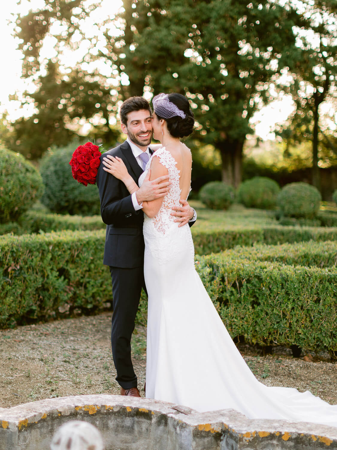 romantic wedding couple kissing on french garden by Portugal Wedding Photographer