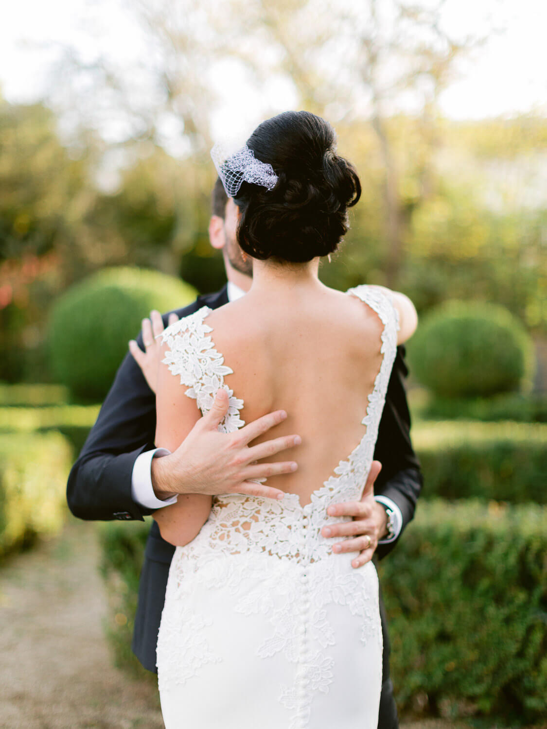 embroidered plunging back wedding dress close up by Portugal Wedding Photographer